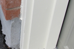 Garage door frame after repairs and exterior painting in Ottawa