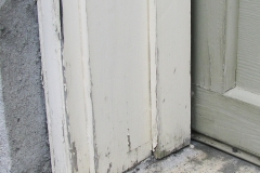 Garage door frame before repairs and exterior painting in Ottawa